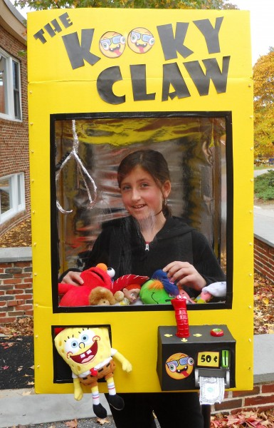 create a claw game halloween costume by cutting a window in an old cardboard box add old toys or dollar store finds and make a claw from tin foil - Halloween Box Costumes