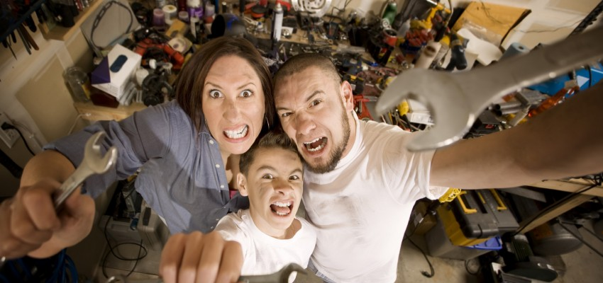 Crazy Do-It-Yourself family with wrenches