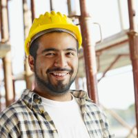 """""""portrait of latin american construction worker, looking at camera"""""""