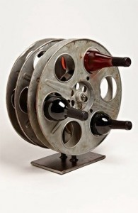Upcycled movie reel wine rack